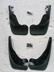 Оригинал  -передние и задние брызговики  на Volkswagen Original Cadd