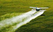 Защита растений с помощью дельтапланов,  вертолетов,  самолетов