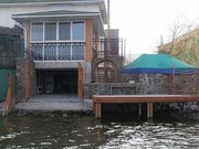 Продается 2-х этажный дом у реки с эллингом для катера